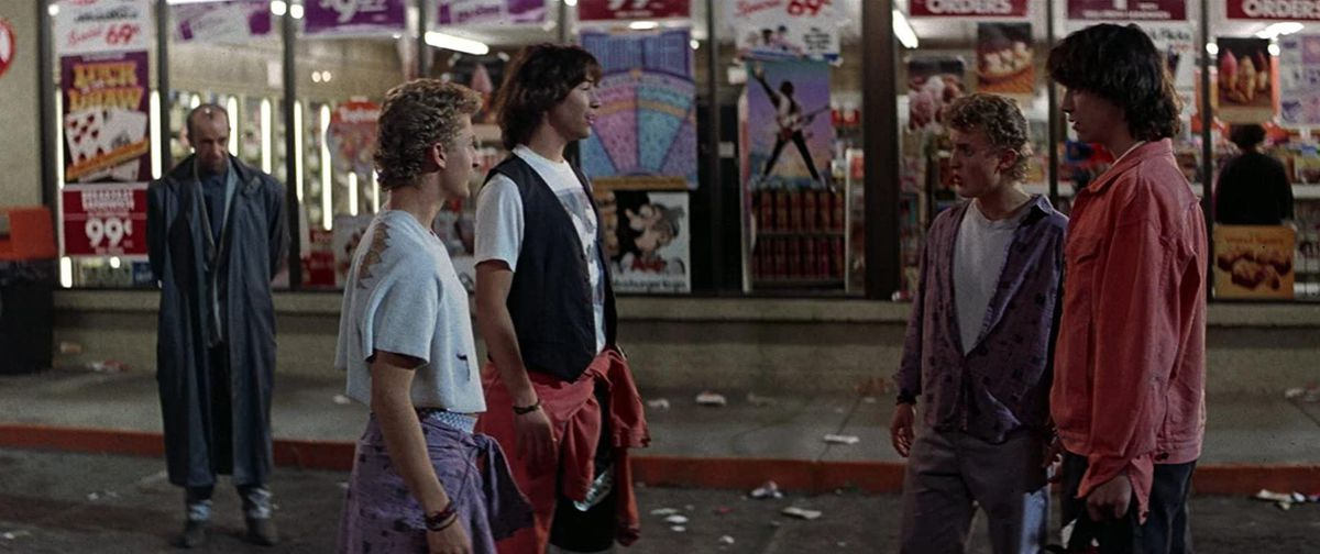 Bill (Alex Winter) and Ted (Keanu Reeves) face each other in front of the Circle K