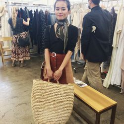 Always stylish Lust for Life blogger Olivia Lopez scored that perfect straw tote at the show.