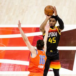 Utah Jazz guard Donovan Mitchell (45) shoots over Oklahoma City Thunder guard Ty Jerome (16) during the game at Vivint Smart Home Arena in Salt Lake City on Tuesday, April 13, 2021.