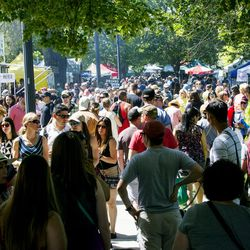 Shoppers take in the opening day of the farmers market Saturday, June 13, 2015, in Salt Lake City at Pioneer Park.