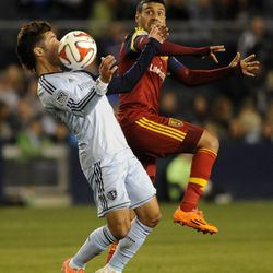 Sporting KC's Benny Feilhaber chests the ball in front of Real Salt Lake's Javier Morales during a game at Sporting Park in Kansas City, Kan., on Saturday, April 5, 2014.