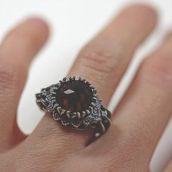 """From BloodMilk, the sterling silver and garnet <a href=""""http://www.etsy.com/listing/121463963/belonging-to-the-darkness-sterling?"""">Belonging to the Darkness Ring</a>, $360"""