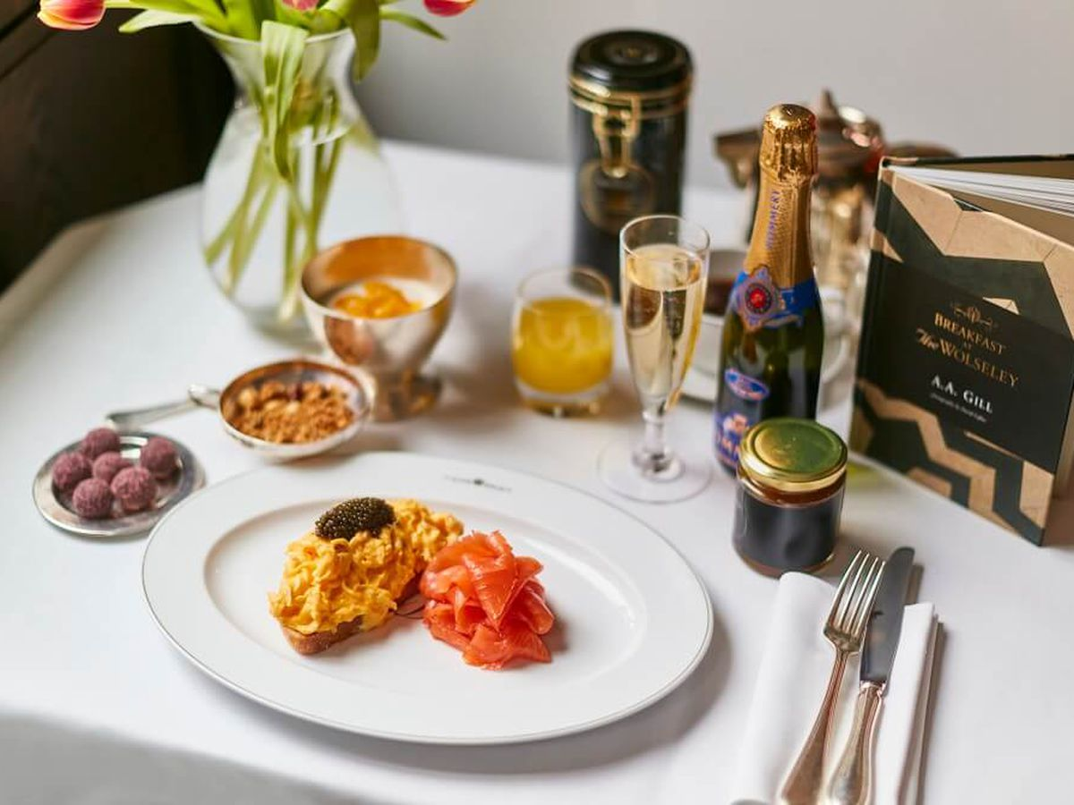 A Mother's Day restaurant kit from The Wolseley, comprising a plate of scrambled eggs on toast with salmon and caviar, champagne, tea, and truffles