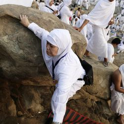 Muslim pilgrims climb a rocky hill called the Mountain of Mercy, on the Plain of Arafat near the holy city of Mecca, Saudi Arabia, Thursday, Oct. 25, 2012. Saudi authorities say around 3.4 million pilgrims — some 1.7 million of them from abroad — have arrived in the holy cities of Mecca and Medina for this year's pilgrimage. (AP Photo/Hassan Ammar)