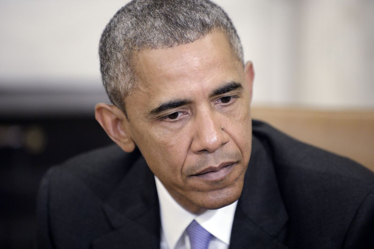 Glum Obama.