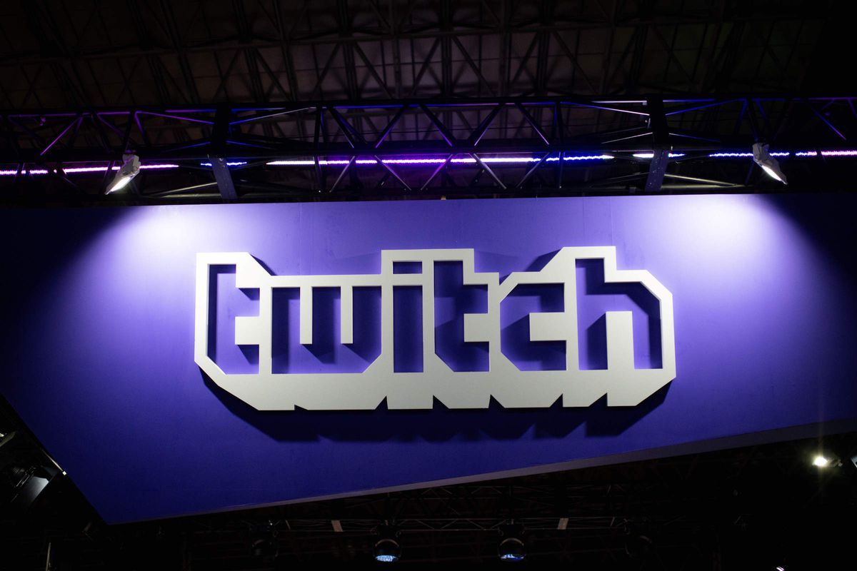 A photo of the Twitch logo at an event booth