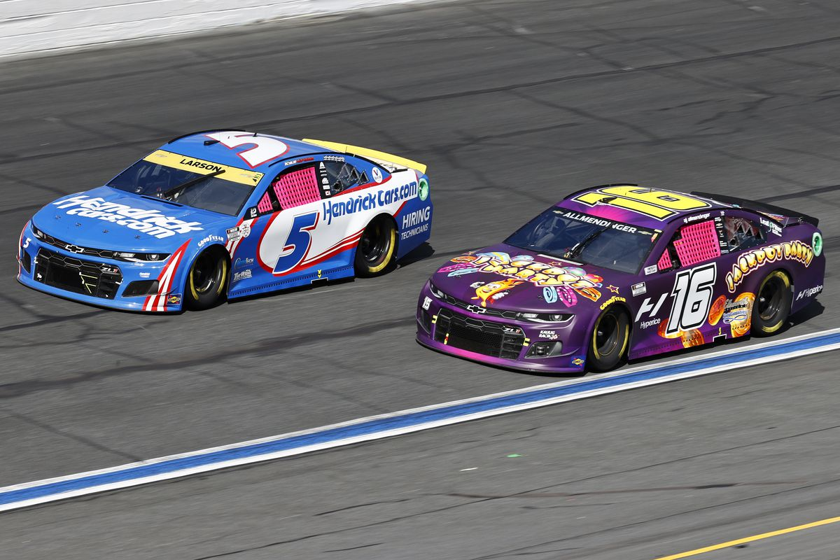 Kyle Larson, driver of the #5 HendrickCars.com Chevrolet, and AJ Allmendinger, driver of the #16 Jackpot Party Chevrolet, race during the NASCAR Cup Series Bank of America ROVAL 400 at Charlotte Motor Speedway on October 10, 2021 in Concord, North Carolina.