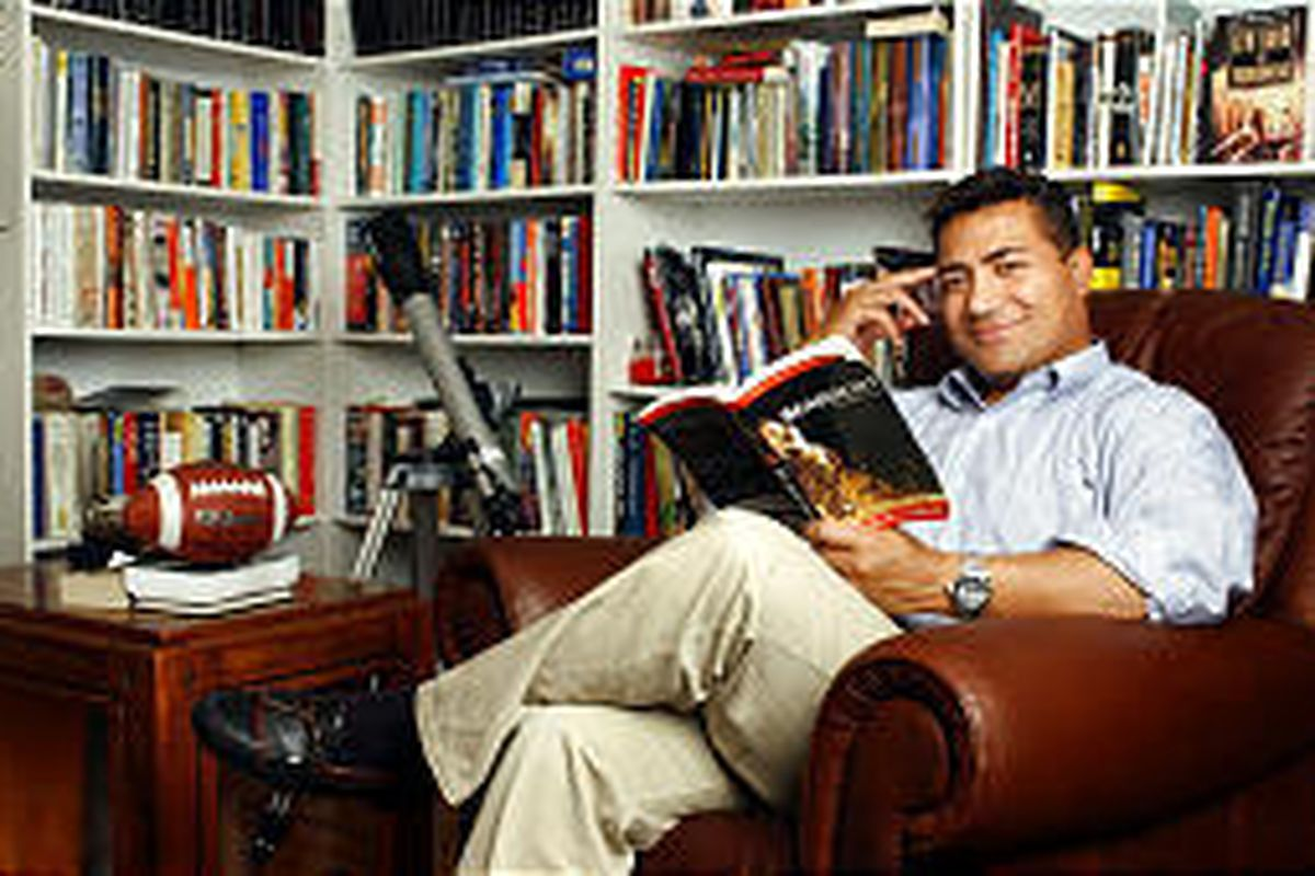 Salt Lake mayoral candidate Molonai Hola relaxes in his reading room at his east side home.