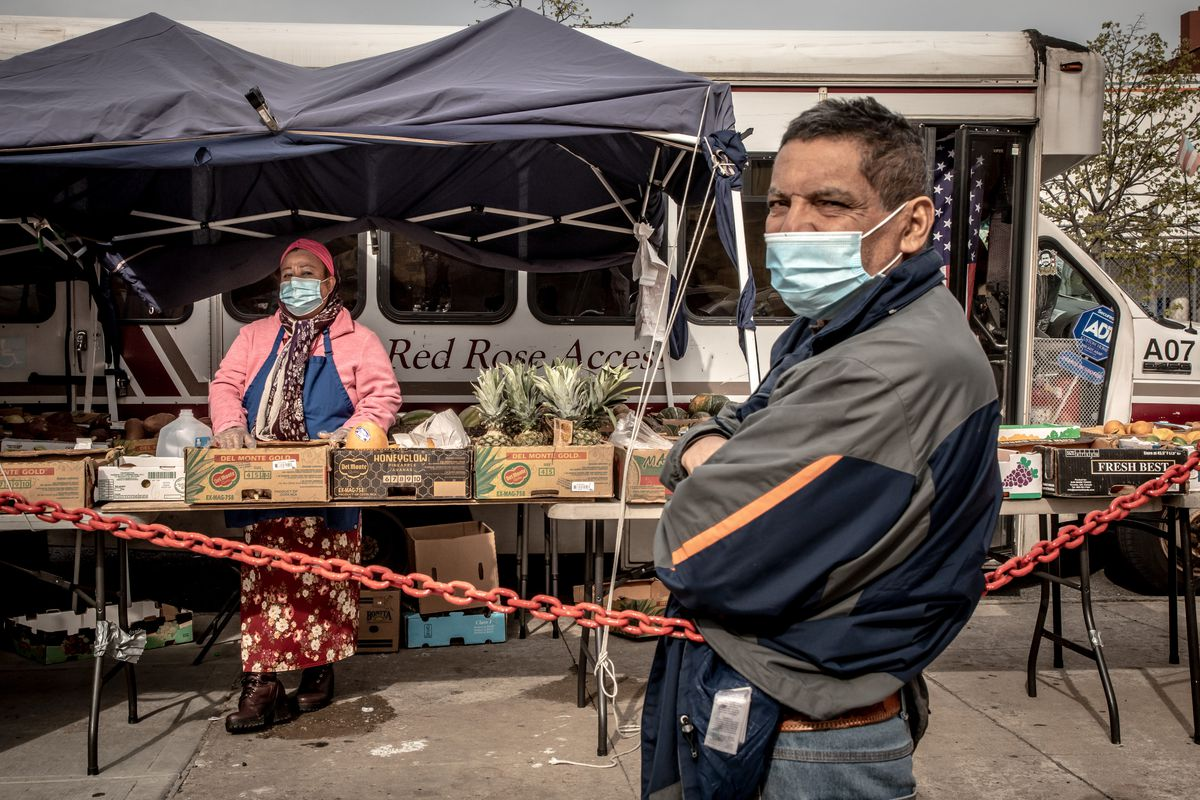 Two street vendors at their produce stand