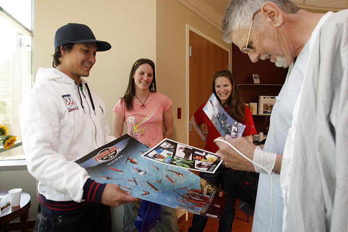 Snowboard cross Olympian Graham Watanabe, left, skeleton athletes Kelly Magnuson and Abby Von Kelsch visit with patient Lynn Zachreson at the Huntsman Cancer Institute in Salt Lake City on Friday. Athletes from past Winter Olympic Games in Nagano, Japan (