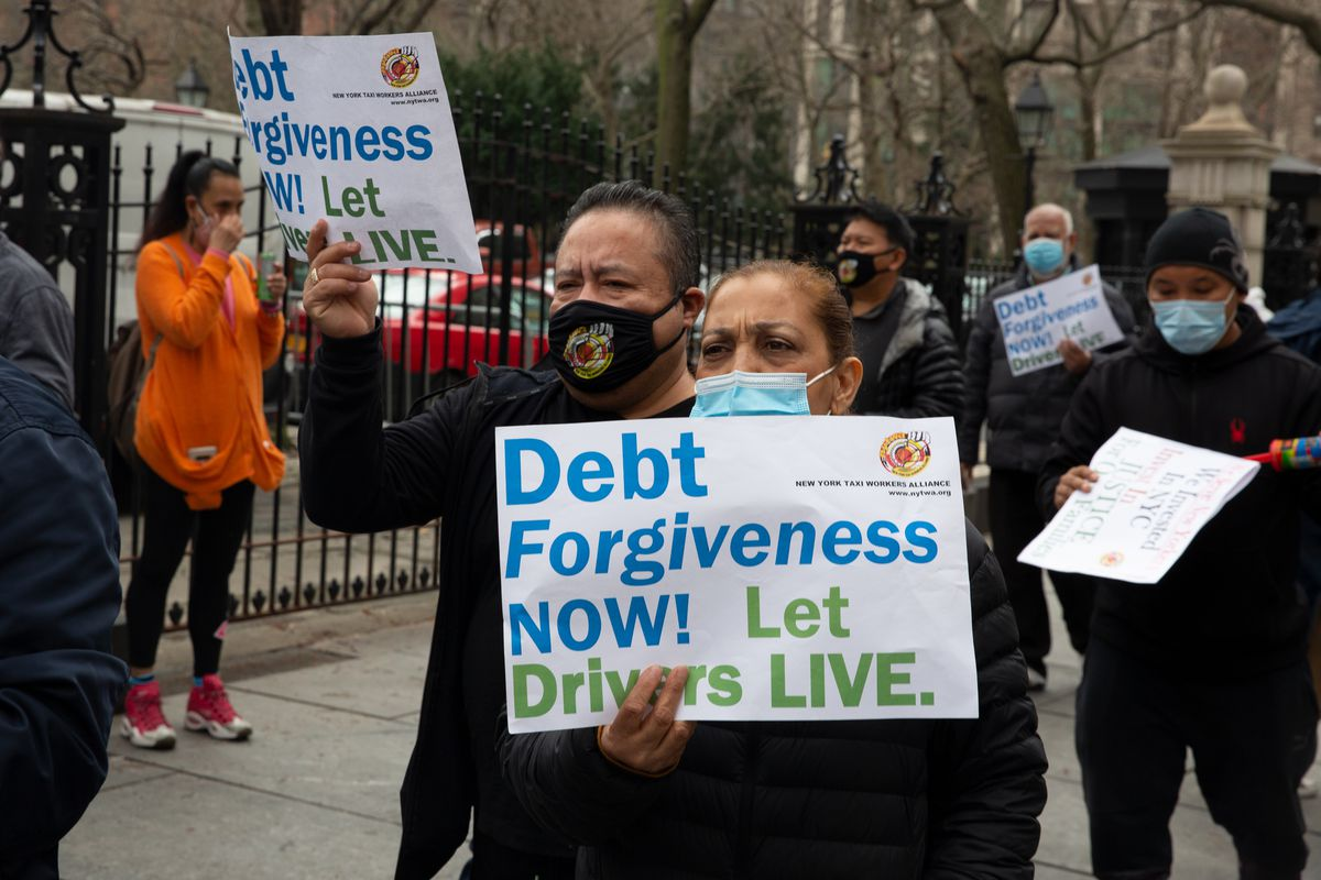 Cab drivers protest in front of City Hall, demanding forgiveness on debts accrued after loss of revenue from ride sharing apps and the coronavirus, March 25, 2021.