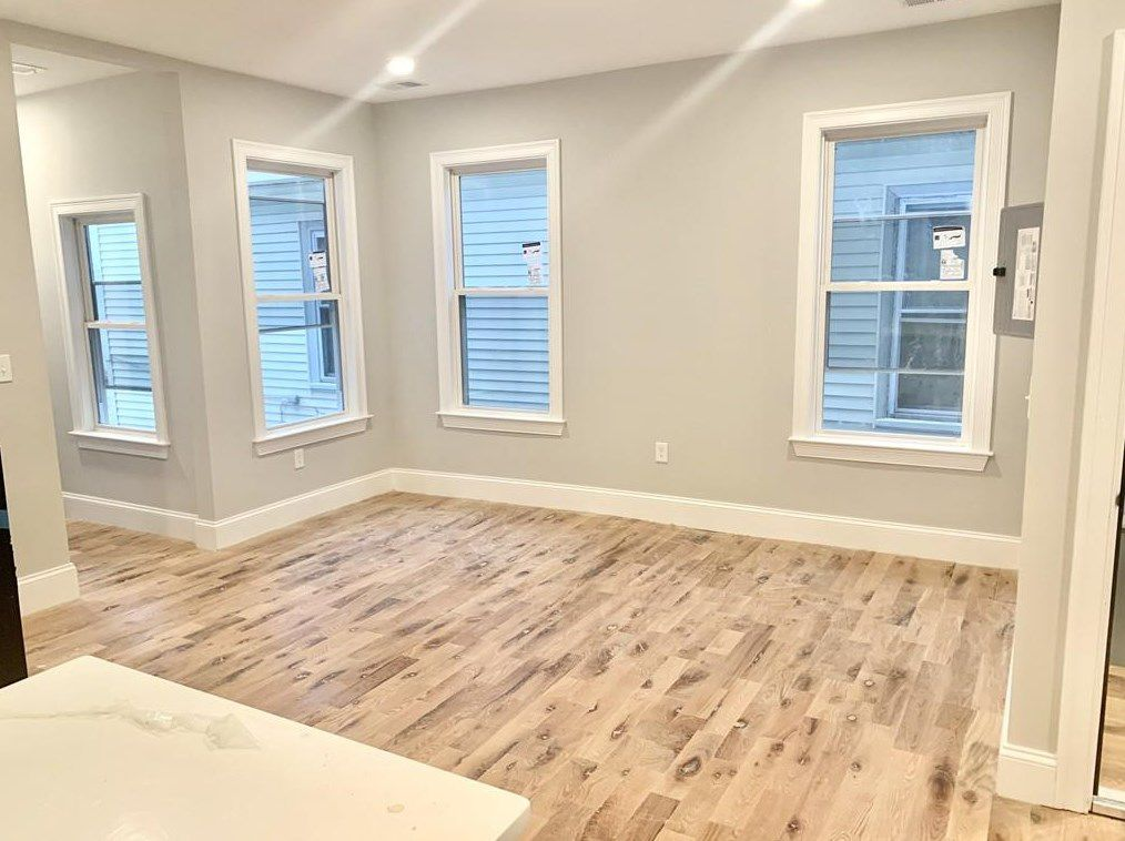 An empty dining room area with windows.