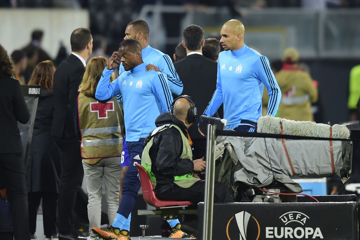 Marseille's Patrice Evra sent off before match after kicking fan