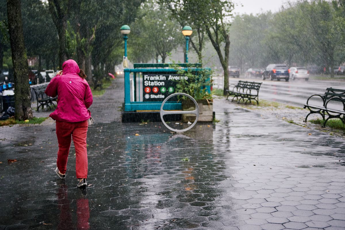 A few people braved the wind and rain on Eastern Parkway in Crown Heights, Brooklyn during Tropical Storm Isaias, Aug. 4, 2020