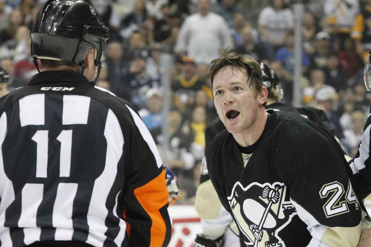 Matt Cooke cannot believe a penalty was called against him in this shot.