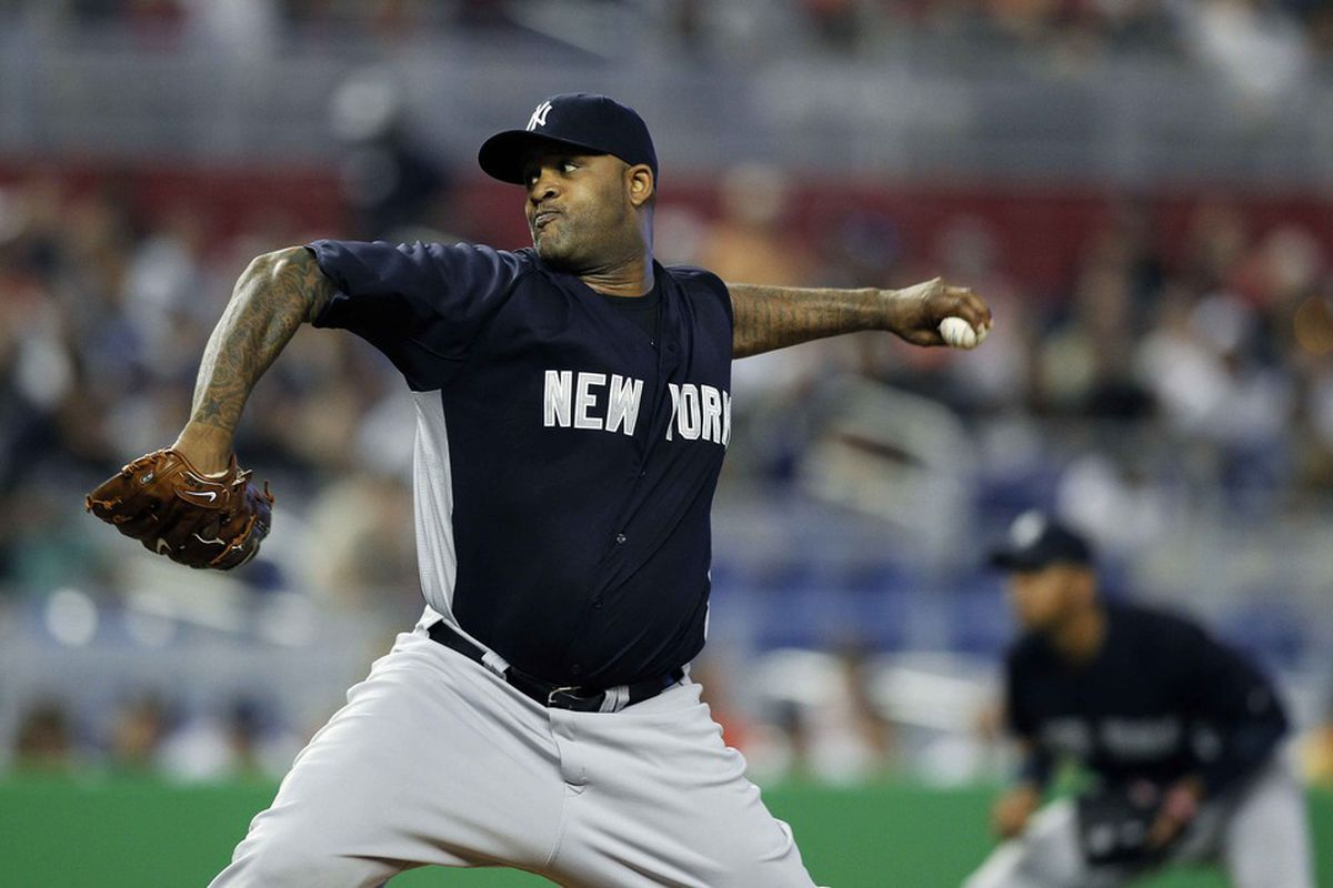 April 1, 2012; Miami, FL, USA;  New York Yankees starting pitcher CC Sabathia (52) pitches in a game against the Miami Marlins at Marlins Park. Mandatory Credit: Robert Mayer-US PRESSWIRE