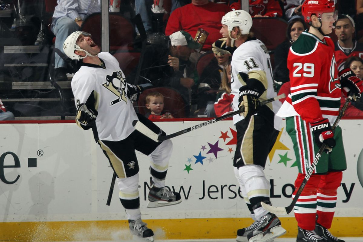 Penguins elated and Devils fans & Mark Fayne disappointed.  Yeah, that sums it up for this game.  (Photo by Bruce Bennett/Getty Images)