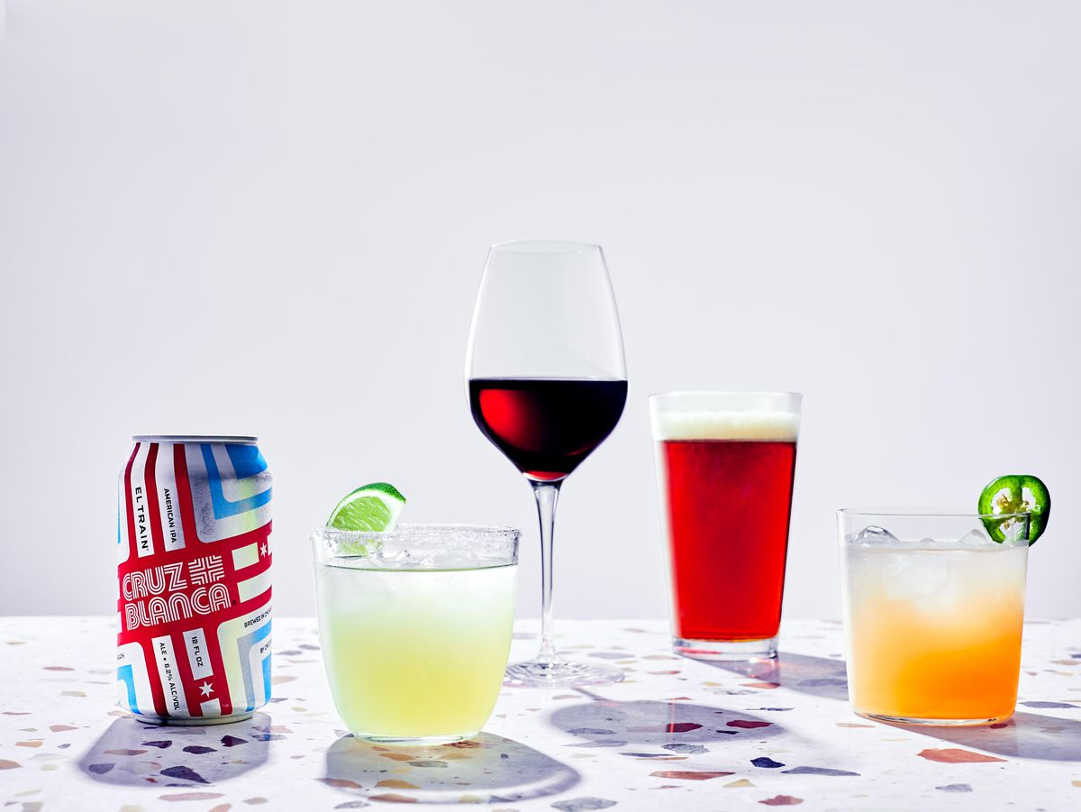 Two cocktails, a glass of wine, a draft beer, and a canned beer.