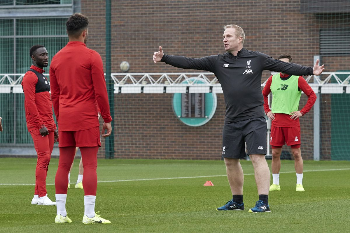 Coach Thomas Gronnemark speaks to the players of Liverpool during a training session at Melwood Training Ground on October 15, 2019 in Liverpool, England.
