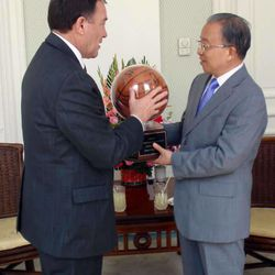 Utah Governor Gary R. Herbert presents a Utah Jazz basketball signed by the team to Dai Bingguo, State Councilor of the People's Republic of China Tuesday, April 12 2011.