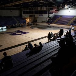 People sit in the stands after power went out at the start of the girls basketball game between Riverton and Syracuse at Riverton High School on Tuesday, Dec. 15, 2020.