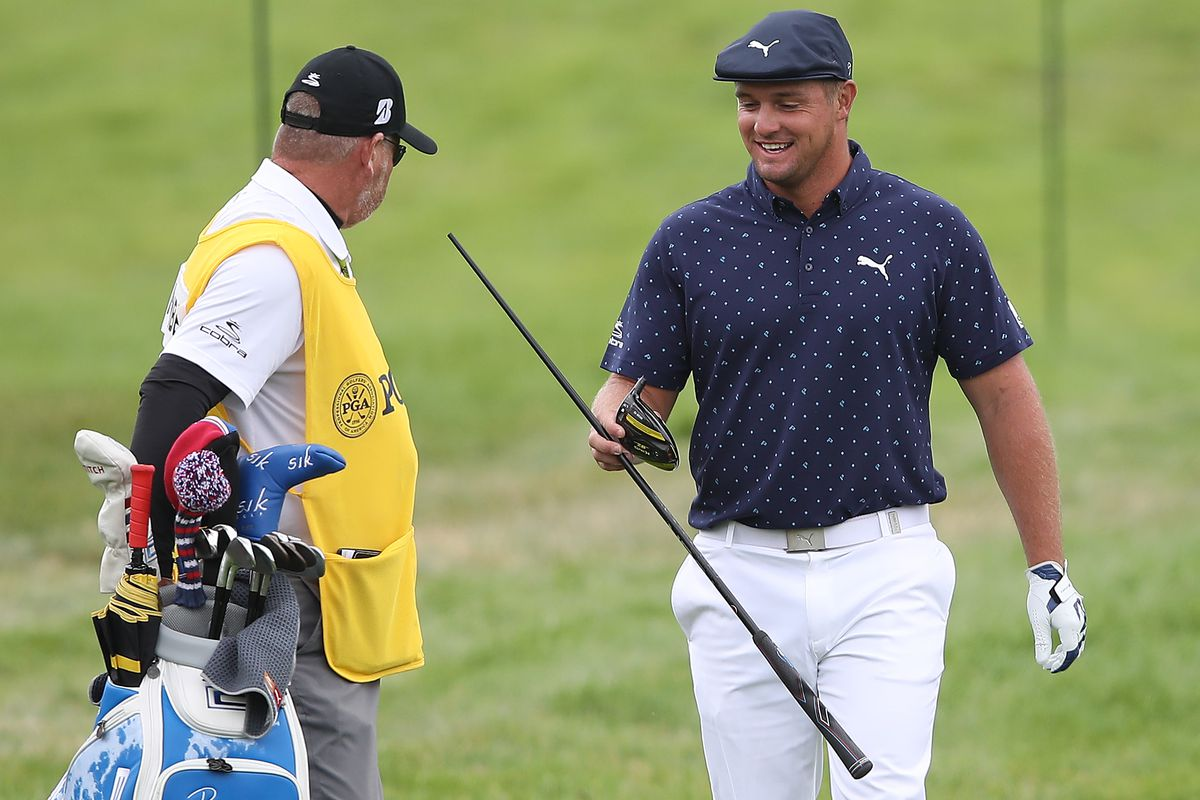 Bryson DeChambeau of the United States hands his broken driver to caddie Tim Tucker on the seventh hole during the first round of the 2020 PGA Championship at TPC Harding Park on August 06, 2020 in San Francisco, California.