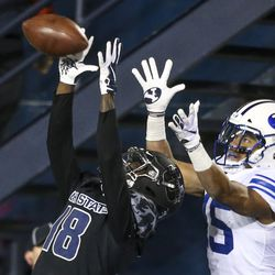 Utah State Aggies cornerback Cam Lampkin (18) intercepts a ball intended for Brigham Young Cougars wide receiver Aleva Hifo (15) in the end zone during the second half of an NCAA football game at Maverik Stadium in Logan on Saturday, Nov. 2, 2019. The Brigham Young Cougars took back the wagon wheel in a dominant 42-14 victory over the Utah State Aggies.