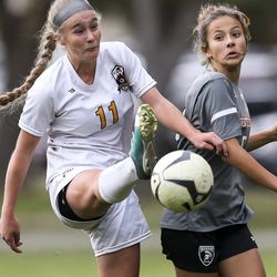 Mountain View's Marinn Waite (11) kicks a thrown in ball away from Murray's Brooklyn Smith (9) during the second half of a 5A quarterfinal girls soccer match at Murray Park in Murray on Thursday, Oct. 17, 2019. Mountain View won the match 3-2.