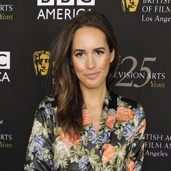 """FILE - This Sept. 22, 2012 file photo shows Louise Roe, Glamour magazine's editor at large and the new host of NBC's """"Fashion Star,"""" posing at the British Academy of Film and Television Arts Los Angeles TV Tea 2012 party at The London Hotel in West Hollywood, Calif."""
