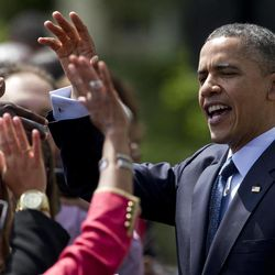 President Barack Obama greets the crowd after a ceremony to honor the NCAA College football BCS National Champion University of Alabama Crimson Tide, Thursday, April 19, 2012, on the South Lawn of the White House in Washington.