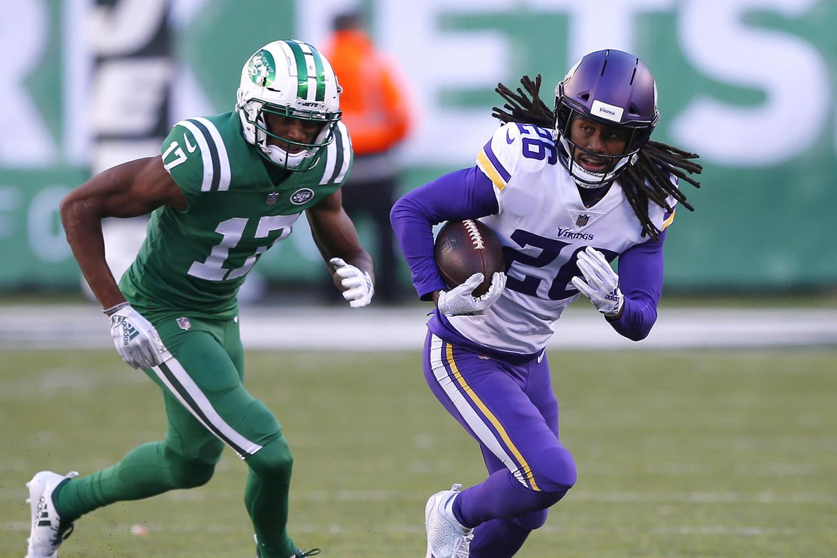 Minnesota Vikings cornerback Trae Waynes runs from New York Jets wide receiver Charone Peake after making an interception during the second half at MetLife Stadium.