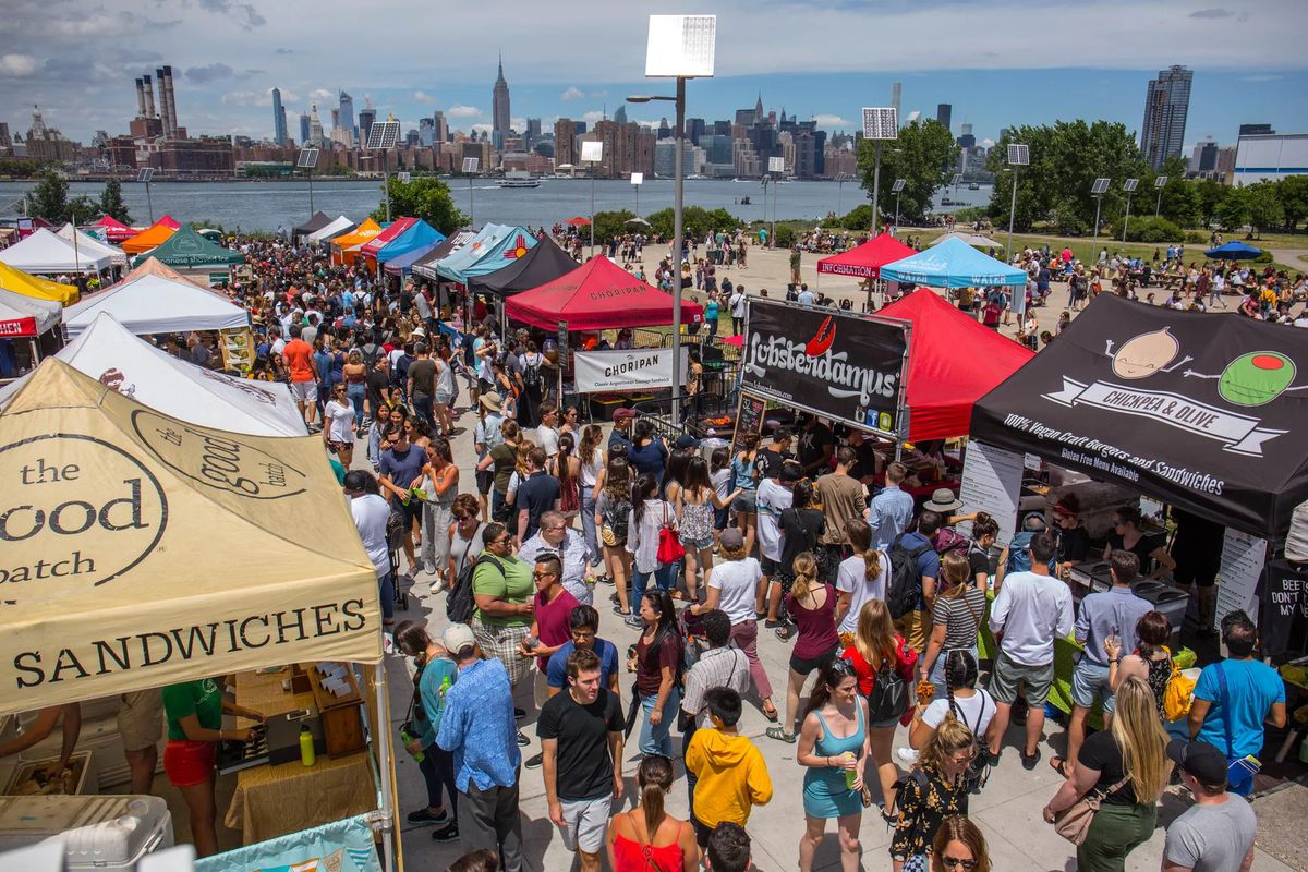 A heavy crowd of people mill about a Smorgasburg market in Brooklyn last year.
