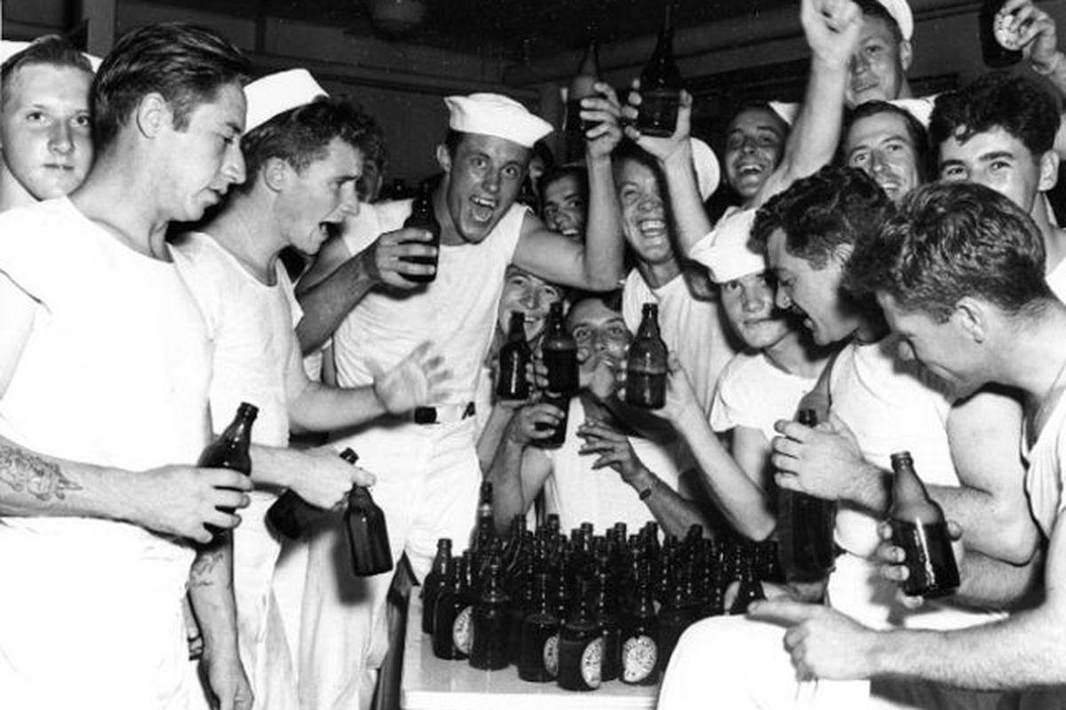 Old-timey sailors drinking.