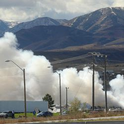 Smoke billows into the sky as West Valley City firefighters respond to a junkyard fire at 5600 West and 2300 South on Monday, Oct. 17, 2016.