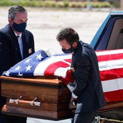 The coffin of Judge Michael Kwan is removed from the hearse at Taylorsville City Hall in Taylorsville on Friday, July 31, 2020. Kwan died July 21.