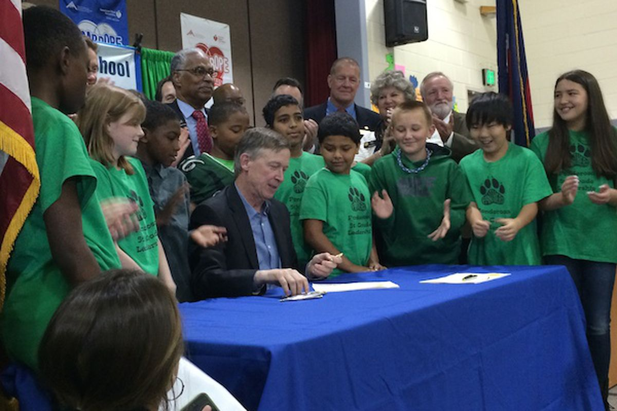 Gov. John Hickenlooper was surrounded by Ponderosa Elementary School students as he signed two 2014 K-12 funding bills.