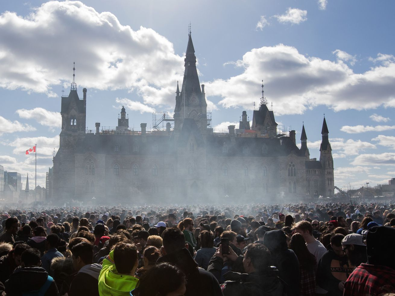 Marijuana smoke lingers in front of Parliament Hill during a 4/20 rally in Ottawa, Ontario, Canada.