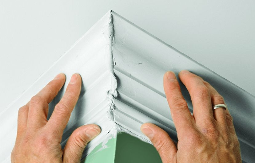 Man Pushes Foam Crown Molding Corners Together