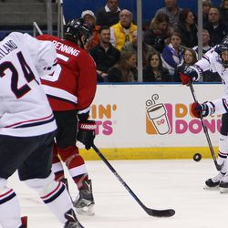 UConn's Max Letunov (27) sends the puck on goal.