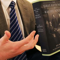 """Matt Grow answers questions as co-editors of """"The First Fifty Years of Relief Society,"""" released by the LDS Church on the Church Historian's Press, are interviewed at the Relief Society Building in Salt Lake City, Monday, Feb. 22, 2016."""