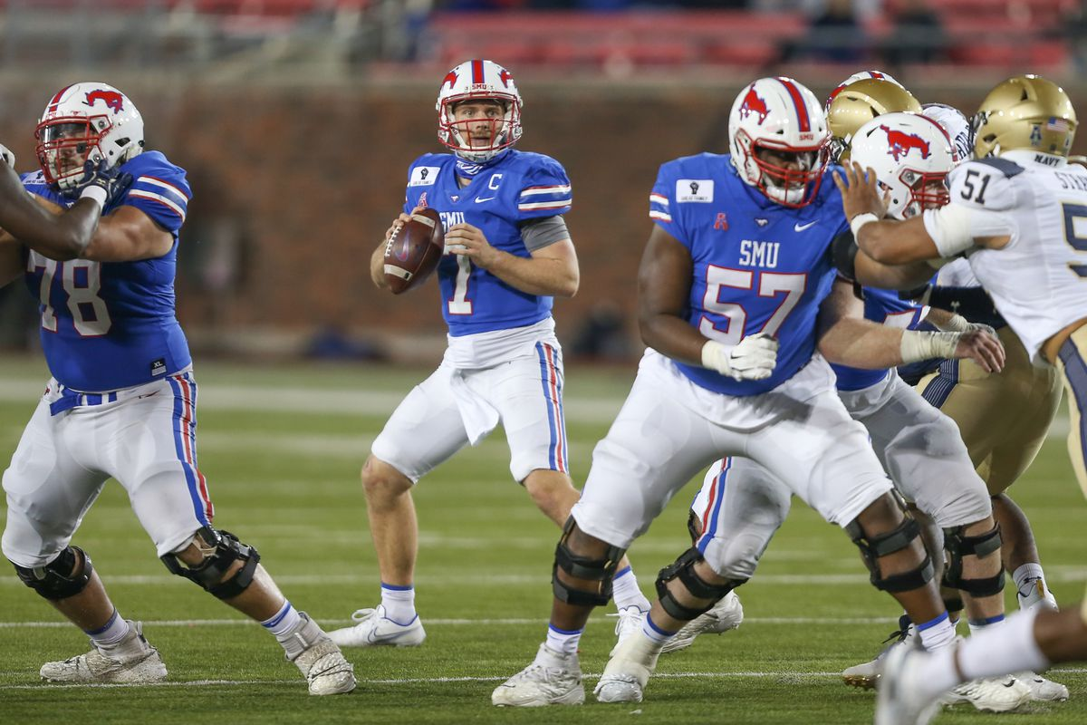 SMU Mustangs quarterback Shane Buechele looks for a receiver during the game between SMU and Navy on October 31, 2020 at Gerald J. Ford Stadium in Dallas, TX.