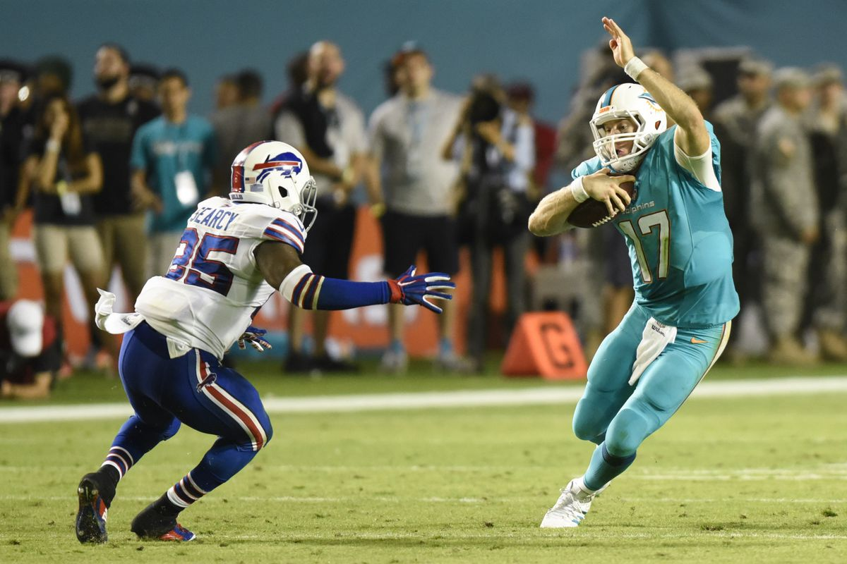 Ryan Tannehill juking out a Bills defender in what was a solid showing for Miami's quarterback