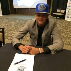 Century, Idaho, senior Malek Harwell signs a basketball scholarship with Boise State University Wednesday at Energy Solutions Arena.