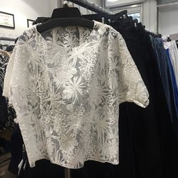6. Maje lace top ($85): This top is so pretty — perfect for a picnic in the park or tucked into a leather pencil skirt for a night out.
