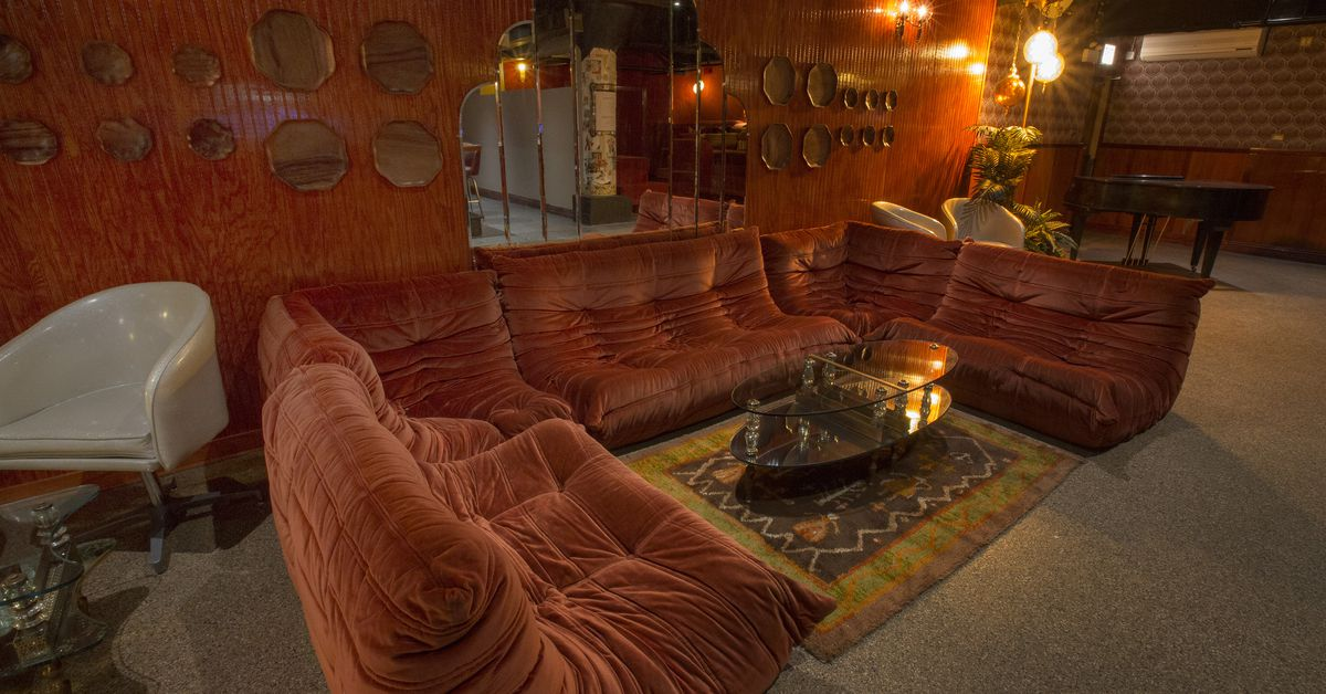 Tour This Funky New Basement Cocktail Den With Comfy Couches and Vinyl Records