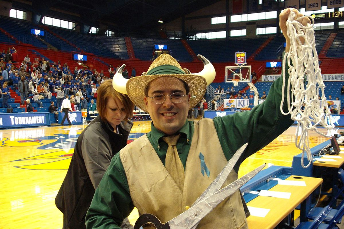 Our man Doc cutting down the nets at Phog Allen Fieldhouse for the Bulls WNIT Championship.