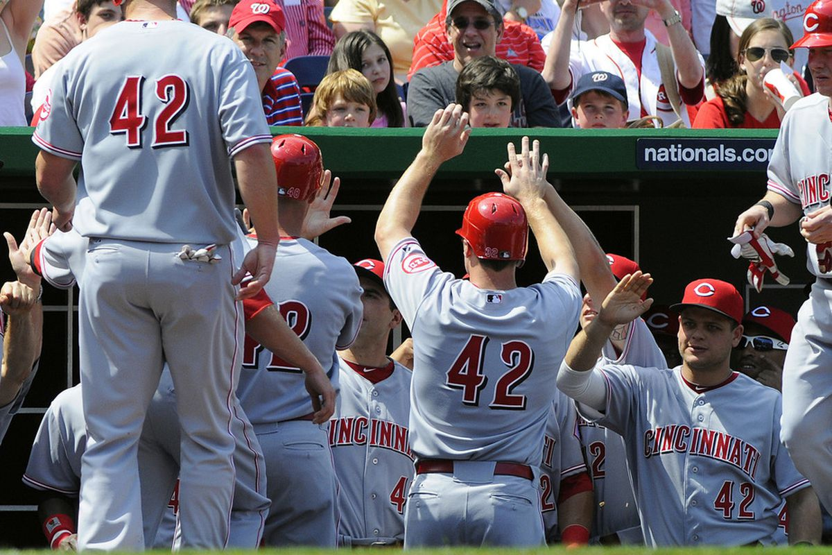 Apr 15, 2012; Washington, DC, USA; Cincinnati Reds left fielder Ryan Ludwick (center) is congratulated by teammates after making that jerk Kevin Mitchell is Batman look dumb by claiming Ludwick was turrrrrible.
