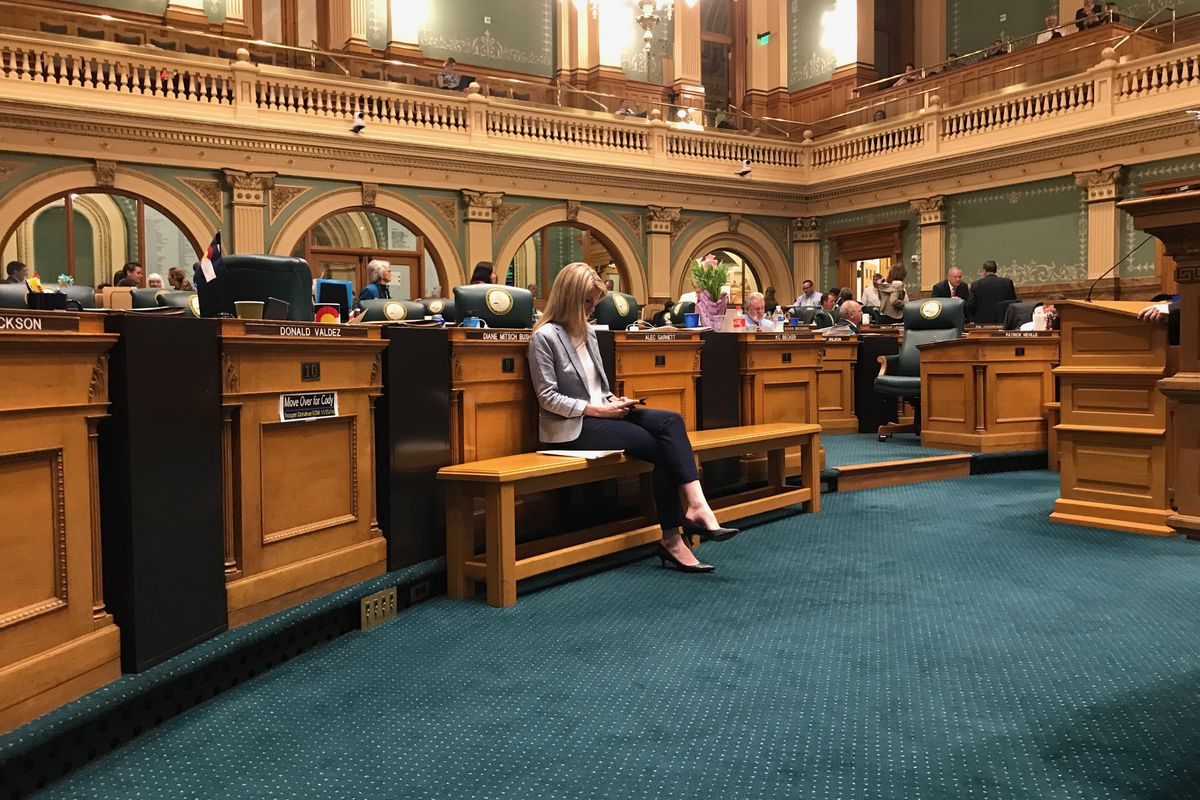 State Rep. Brittany Pettersen, a Lakewood Democrat, sits alone on the House of Representatives floor as members of her own party filibustered her compromise on charter school funding. (Photo by Nic Garcia)