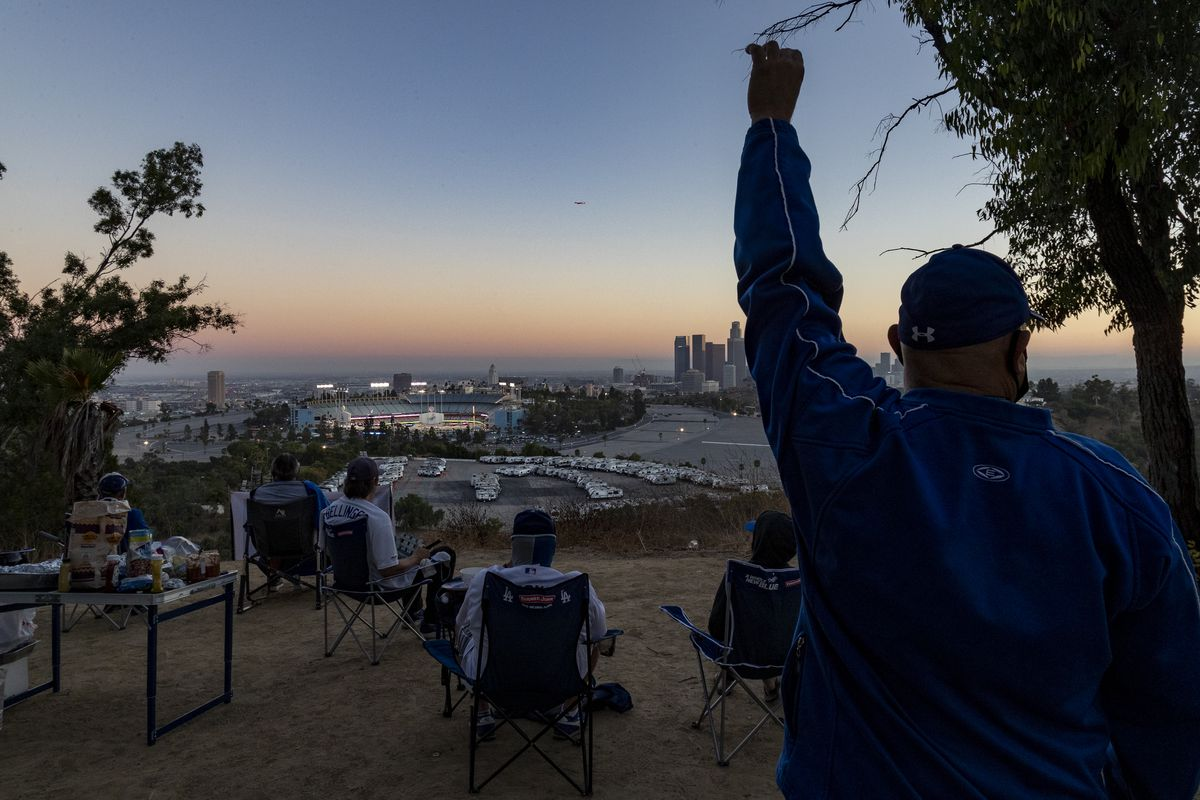 Fans watching Dodger game from afar at Elysian Park in Los Angeles, CA.