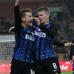 Facundo Colidio (L) of FC Internazionale celebrates his second goal with his team-mate Emmers Xian Ghislaine (R) during the Primavera SuperCup match between FC Internazionale U19 and AS Roma U19 at Stadio Giuseppe Meazza on January 7, 2018 in Milan, Italy.